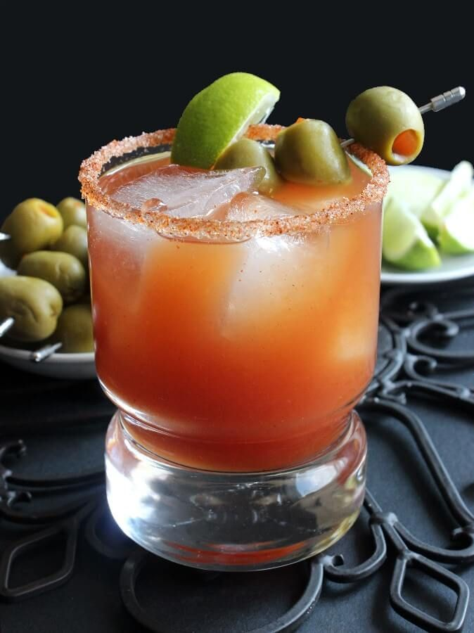 Michelada – The Mexican Bloody Mary ~ http://vegaIngredients  For the drink: 6 ounce tomato juice or Bloody Mary Mix 1/4 cup lime juice - 2 to 3 limes 2 teaspoons worcestershire sauce 1 teaspoon hot sauce (you may add more after trying the finished product) 1 can/bottle 12 ounce of your favorite beer (I used Dos Equis) green olives - optional lime wedges - optional For the rim of the glass: 2 tablespoons coarse sea salt 2 teaspoons chili powder