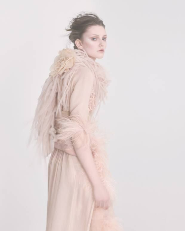 Prada silk chiffon and ostrich feather dress, £1,590. Rosamosario Chantilly lace and silk Nudita Ricca bra (worn over dress), about £235. Elizabeth Emanuel Studio tulle and silk satin boa, price on request, madeto order. VV Rouleaux silk rose (under boa), £49