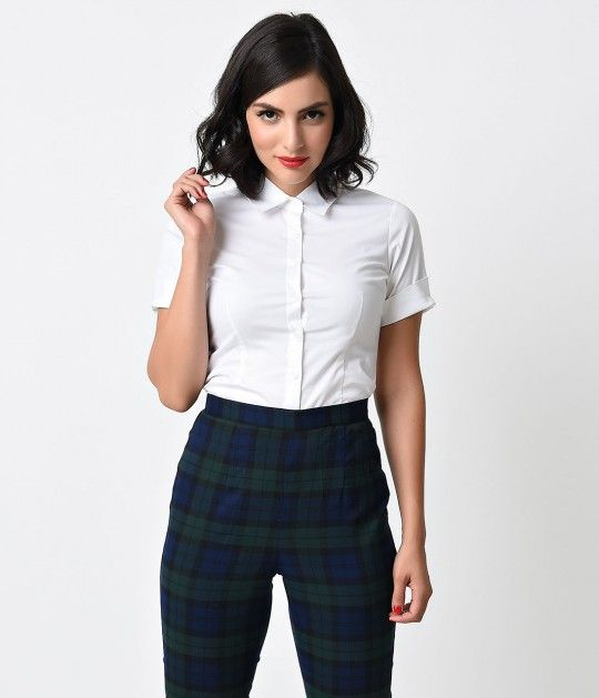 A salaried staple, dames! A charming button up blouse in classic white, boasting notch cuffed short sleeves and darting for feminine form with a classic collar. Crafted in a sturdy woven cotton blend, it's the consummate canvas. Nailed it! <br />Available