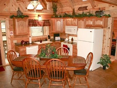 Kitchen idea.  Like the decor on top of the cabinets.