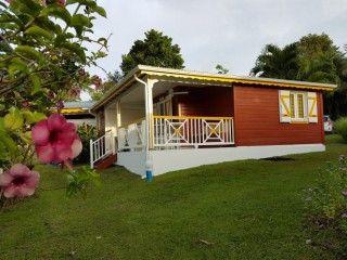 Anguilla Case créole / piscine dans jardin tropical 4 personnes (Réf:5837 Bungalow Guadeloupe PetitBourg)