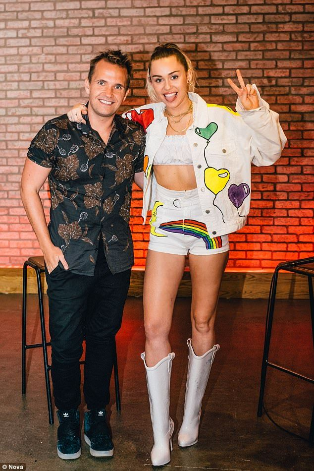 L.I.A.M:Miley Cyrus wore an earring that spells out boyfriend Liam Hemsworth's first name, Liam, to a performance in New York on Thursday