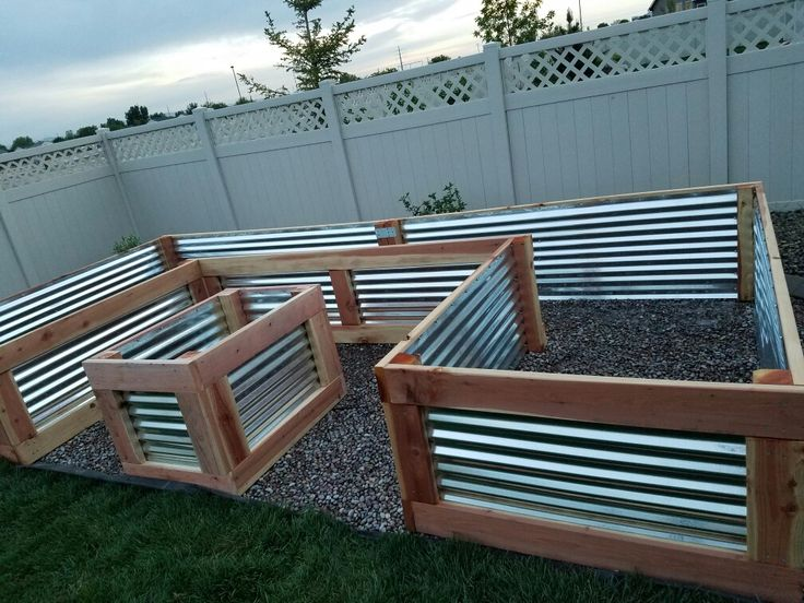 Beautiful custom raised garden bed my husband and I just finished. It turned out perfect!  Used redwood and galvanized sheet metal. Measures 4 ft W x 8 ft  x 16 ft x  27 in H.