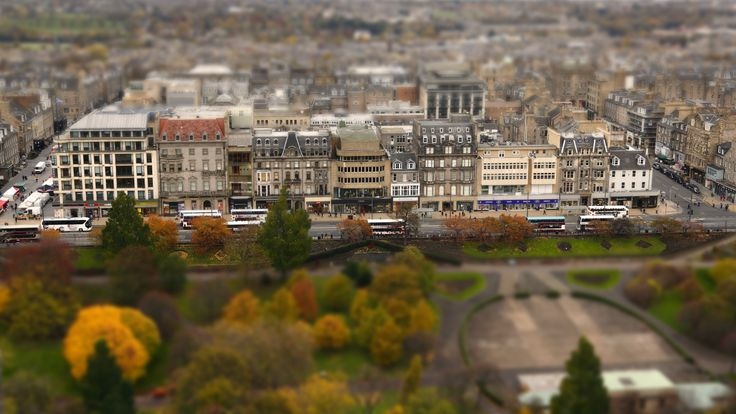 Tilt-Shift image of 'Princes Street' Edinburgh.  Not only was selective focus added in post production but the image saturation was also increased slightly.  The very high viewpoint makes for an ideal image for 'Tilt-shift'...and creates that 'model village' illusion.