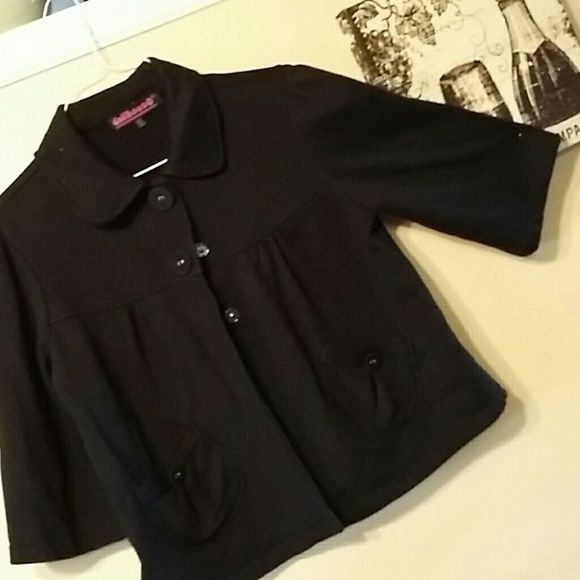 Dollhouse black baby doll jacket XL Half button up, black baby doll jacket XL by Dollhouse. Two front pockets with button details. Three quarters length sleeves. Pleating detail.  In great shape.  A very versatile jacket. Dollhouse Jackets & Coats