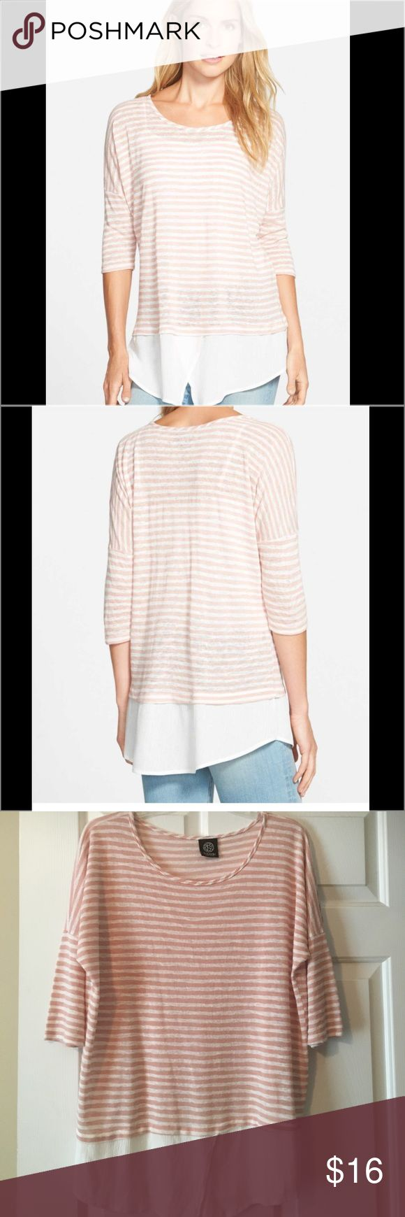 "Bobeau Layered Look Stripe Top EUC A lightweight woven inset forming a shirttail hem brings a pulled-together layered look to a striped knit top with slouchy drop-shoulder styling. 30"" length (size Medium). Scooped neck. Three-quarter sleeves. 62% rayon, 38% polyester with 100% rayon contrast. By Bobeau; made in the USA. bobeau Tops"