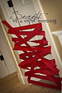 Crepe paper the door for Christmas so they have to bust out when they wake up. Santas elves did this to make sure they stayed in their rooms. Super cute idea!!