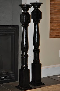 large candle holders made from stair posts