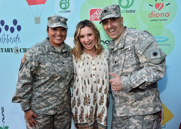 Beverley Mitchell Photos Photos - Actress Beverly Mitchell poses with members of the U.S. Army at the Step2 & Favored.by Present The 5th Annual Red Carpet Safety Awareness Event at Sony Pictures Studios on September 24, 2016 in Culver City, California. - Step2 & Favored.by Present the 5th Annual Red Carpet Safety Awareness Event