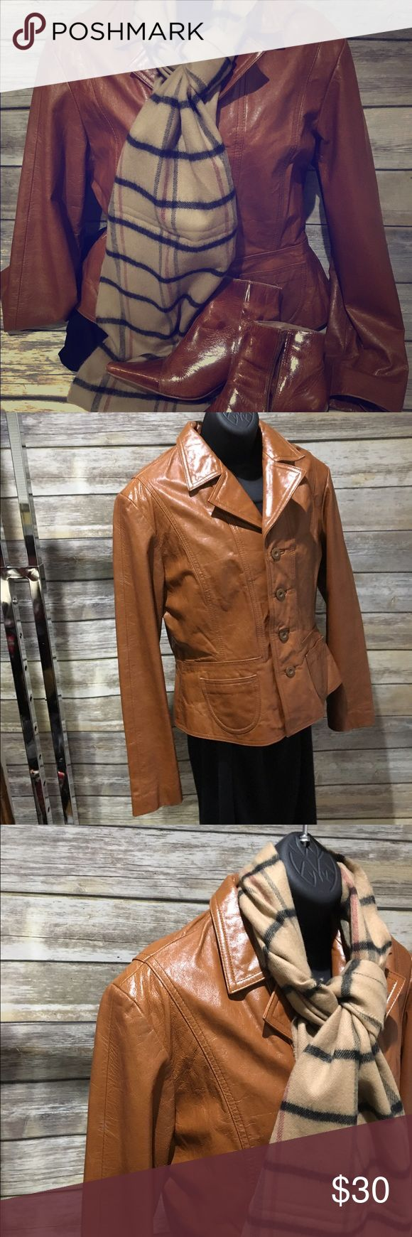 Wilsons leather jacket Cognac leather jacket. No damage, but normal leather wear. Pointed toe boots (size 6.5) included at no additional cost, if interested. Wilsons Leather Jackets & Coats