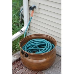 garden hose storage great idea if you have some empty pots around - Garden Hose Storage