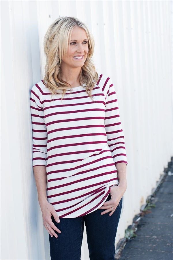 Striped shirts are a wardrobe essential. The length of these are perfect to wear with jeans or leggings. They look darling worn alone or layered under your favorite vest or jacket. 95% Rayon 5% Spandex Made in the USA.COLORS: BlackBurgundyMochaNavySIZES: Small (0-4)Medium (6-8)Large (10-12)Model is wearing a size small.