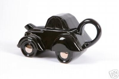 A rare all black version this teapot was designed and made by Andy Titcomb in 1986, it was originally sold through Citroen dealerships in the UK