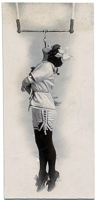 Edwardian era circus performer Pansy Chinery (c. 1916) dangling in the air by her teeth. #circus #vintage #1910s #Edwardian #woman #performer