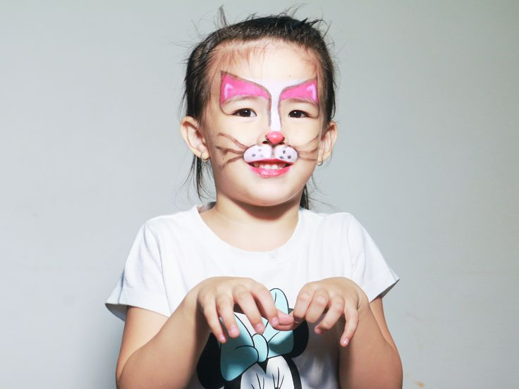 Face paint a cat face day of the dead girl cat nose