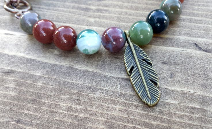Indian Agate with a Feather Charm by NidraBeads on Etsy