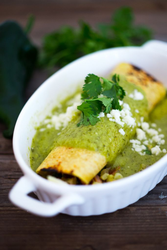 Smoked Chicken Enchiladas with sweet corn, poblanos and a vibrant flavorful Tomatillo sauce. | www.feastingathome.com