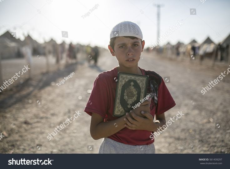 Sanliurfa Turkey September 23,2015 A boy posing with holly Kouran in Akcakale Refugee Camp. Approximately 28.000 Syrian people reside in Akcakale Tent Camp in Urfa.