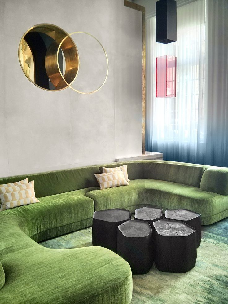 Such a stunning living room where the green velvet go amazingly with the stone…
