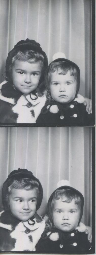Vintage photo booth portrait. BIG SISTER W/. FRIGHTENED LITTLE SISTER.