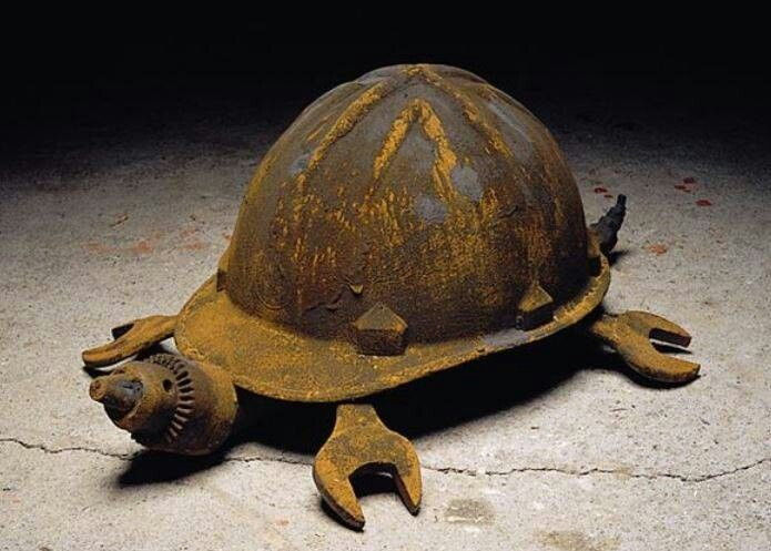 Turtle made out of a hat and tools.