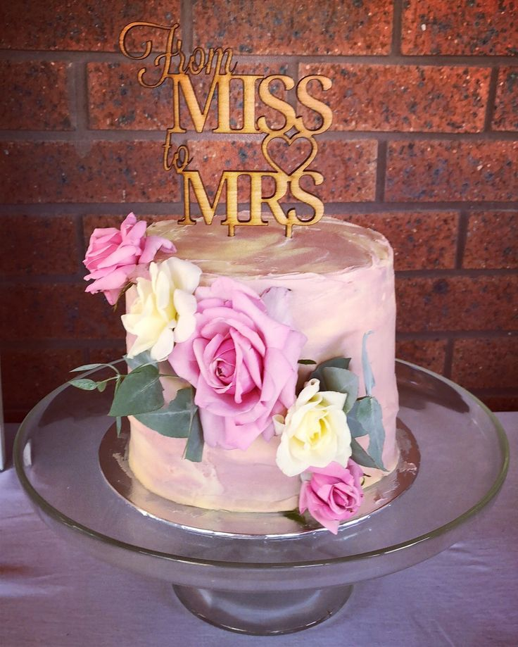 From Miss to Mrs  bridal shower cake. Topper from Pinkswann2012 on eBay. Chocolate cake with fresh roses from my Gramma's garden and some gum leaves
