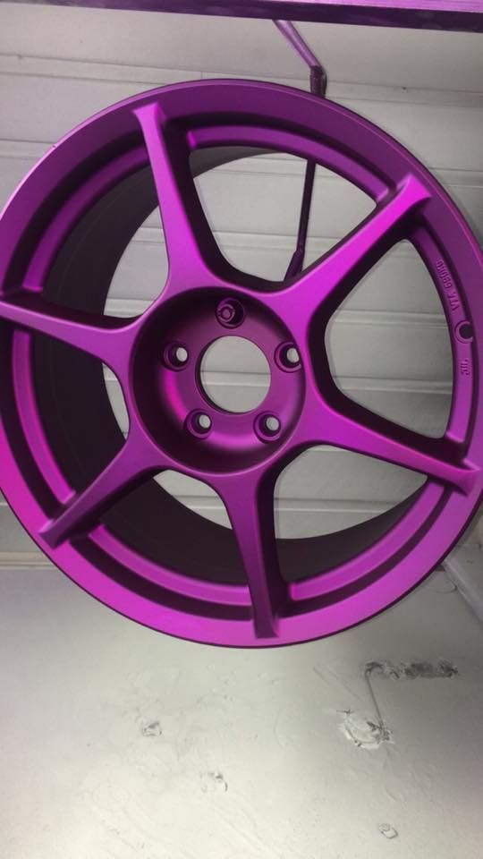 Purple + matte clear powder coating.  Learn to powder coat at http://www.powdercoatguide.com/