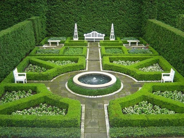 love the boxwood hedges and classic bisimetrical design