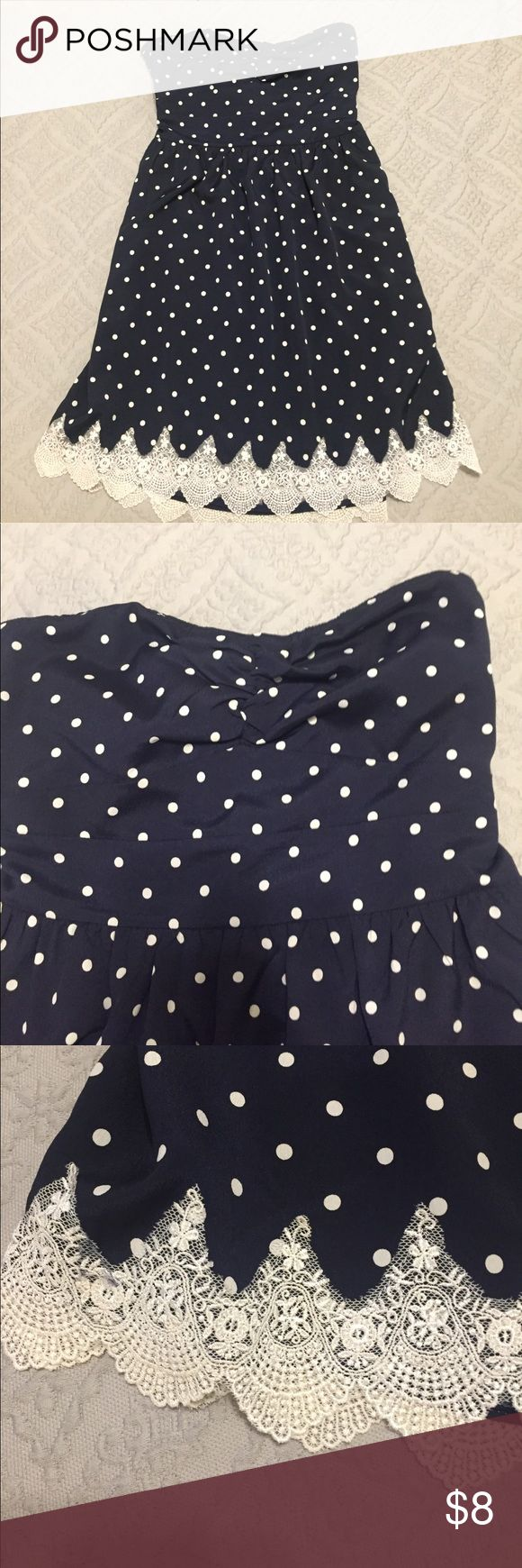 Polka dot summer dress! Such a cute dress! Navy with white polka dots, lace along the bottom, and ties in a bow in back! Size M but would better fit a small. Dresses