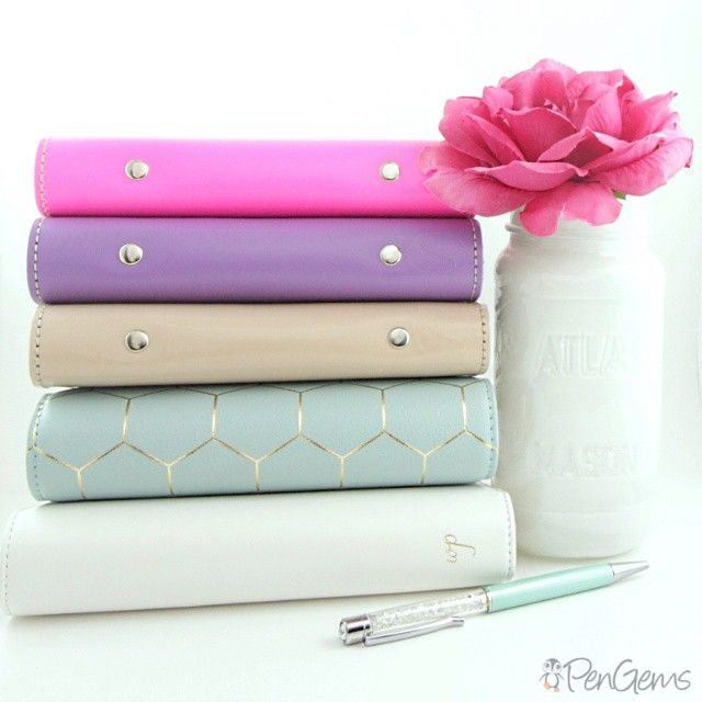 Which one should I move in to next? Filofax Originals in Fluro Pink, Lilac, and Nude. Kikki.K in Dark Mint. Websters Pages Color Crush in white. PenGems crystal pen in Iced Mint.