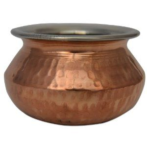 Copper & stainless steel made serving platters, buckets, serving bowls, serving handis, karahi or serving pan are made made broad-rimmed with deep hammered finish. These serving pans used only for serving daals (lentils), kheer (rice pudding) chicken curry, and other dishes with a liquid base. The particular copper servewares shown above are more suited for serving food than cooking. Double layer of metals with air cushion minimizes heat radiation.