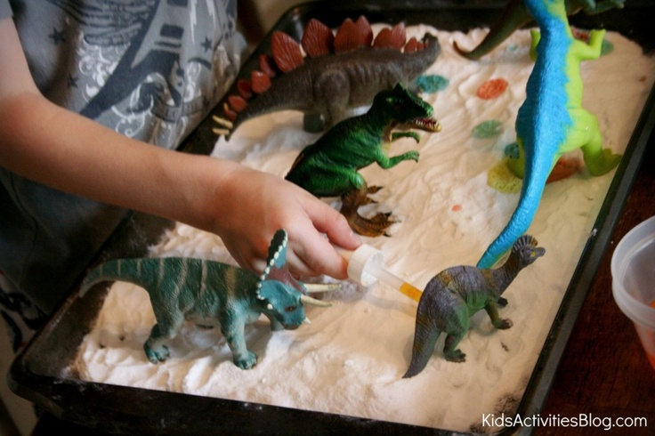 "Dinosaurs on a tray of baking soda - add drops of food colouring mixed with a little vinegar ("",)"