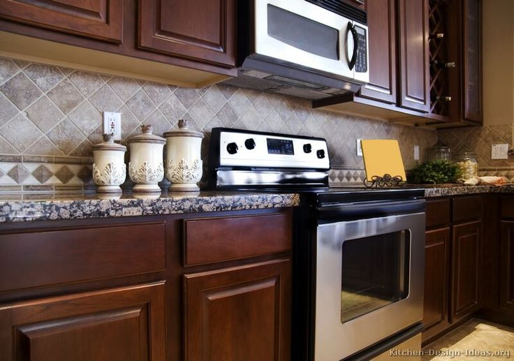 #Kitchen Idea of the Day: Traditional dark cherry-stained kitchen with diagonal travertine tile backsplash.