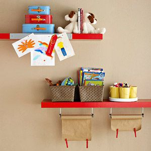 Hang paper towel bars underneath a shelf to store crafts paper. Weigh the edges down with clothespins to keep from curling.