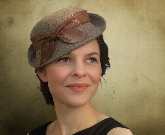 Helena Brown  This simply elegant hat is a gorgeous combination of fascinator, cloche and 1930s slouch hat with a touch of pill box in the mix. 1 of 2