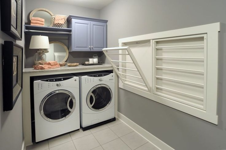 wall laundry drying room eclectic with stacked washer dryer wicker rattan baskets