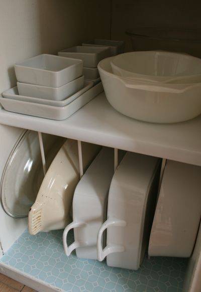 kitchen ideas sideways storage all those casserole dishes and baking pans too use tension rods