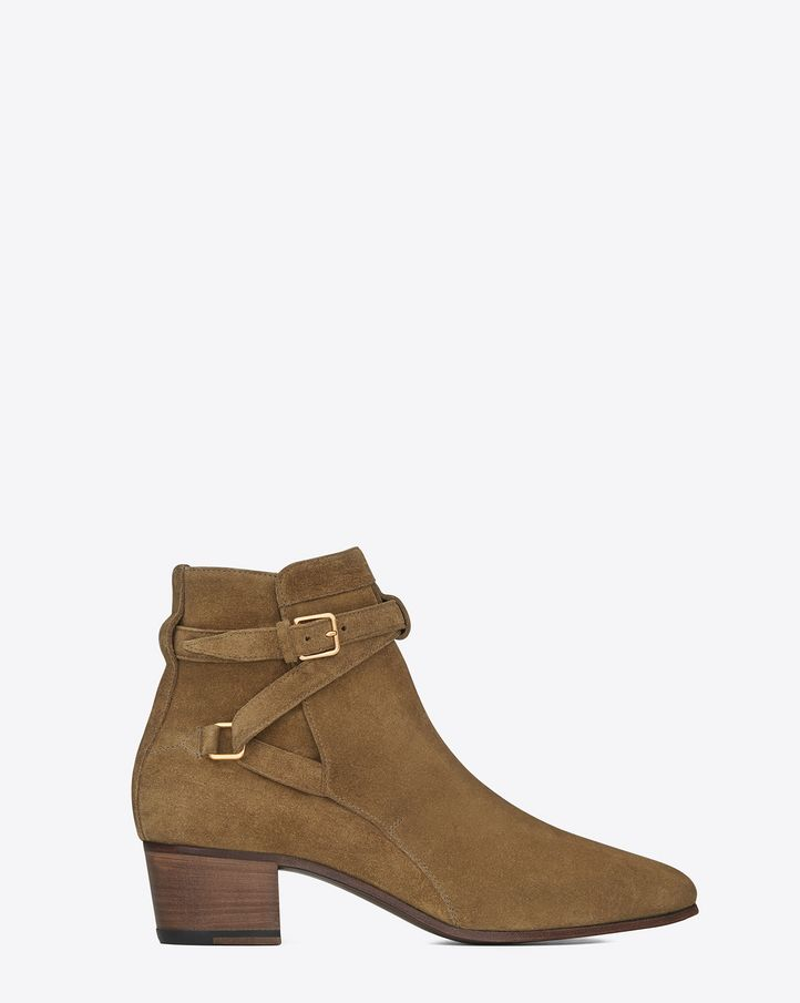 SAINT LAURENT SIGNATURE BLAKE 40 JODHPUR BOOT IN CIGAR SUEDE  $ 895.00 CLASSIC SAINT LAURENT MEN'S JODHPUR BOOT FOR WOMEN WITH ANKLE STRAP, BRASS BUCKLE AND PULL TAB. TOTAL HEEL HEIGHT 1.6 INCHES 100% GOATSKIN LEATHER SOLE STYLE ID 316237CLT002712 MADE IN ITALY