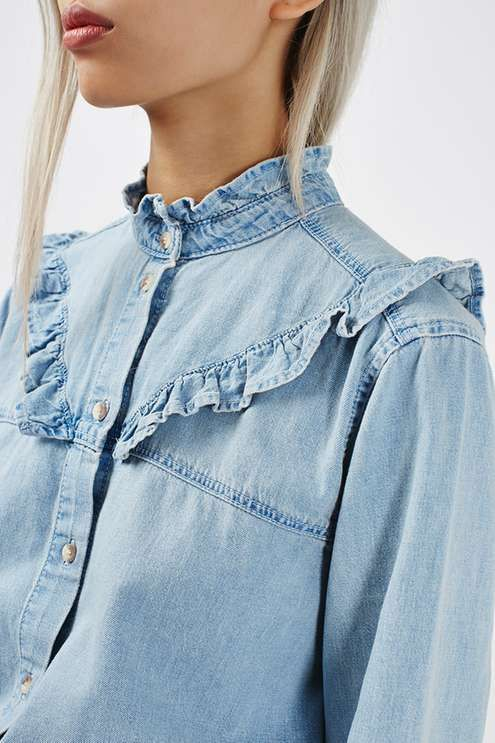 We love the frill styling to the front, sleeves and neck of this denim shirt, adding a cool twist to the wardrobe staple. Wear tucked into jeans and opt for the double denim look. #Topshop