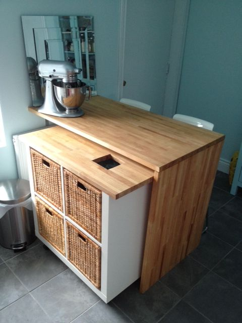Roll-away kitchen island from IKEA EXPEDIT shelf and LAGAN countertop. Neat solution for storage, extra countertop space, and extra seating.