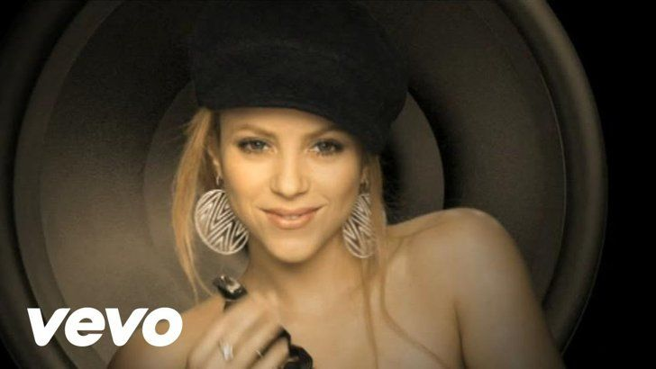 "Pin for Later: 15 Shakira Music Videos That Are Too Hot to Handle ""Give It Up to Me"" featuring Lil Wayne"