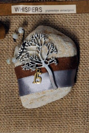 handmade charm on pebble