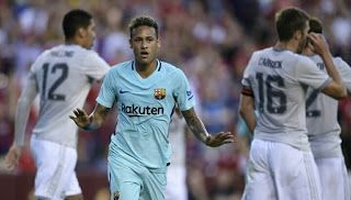 Neymar, serene amid a frenzy of transfer speculation, scored the first-half goal that gave Barcelona a 1-0 victory over Manchester United...