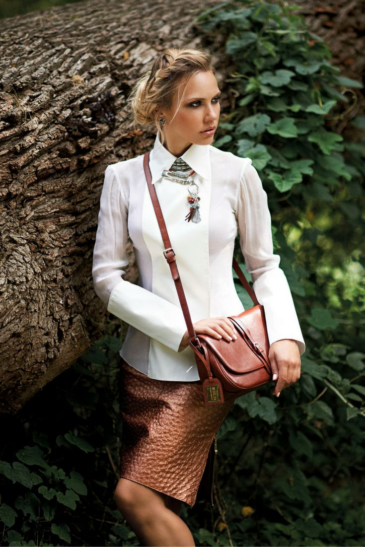 Create a contrast by wearing boho-inspired jewellery with a structure white blouse and modern pencil skirt.