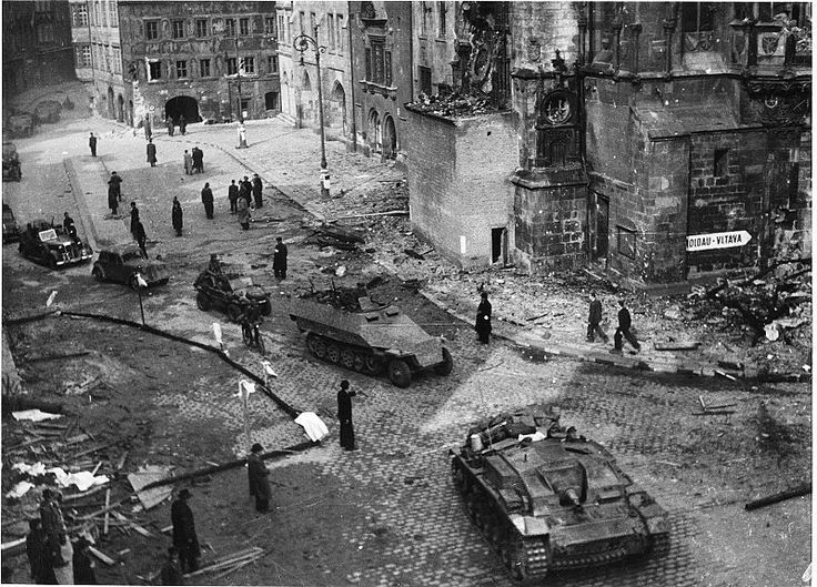 """May 1945, Prague: Retreating SS troops after an agreement with local resistance for safe passage. On May 9, one day after this photo was taken, the Red Army arrived as """"liberator."""" US recon troops already in the suburbs were ordered NOT to help the resistance due to a political agreement with Stalin. Even the good guys make terrible mistakes that cost rivers of innocent blood."""