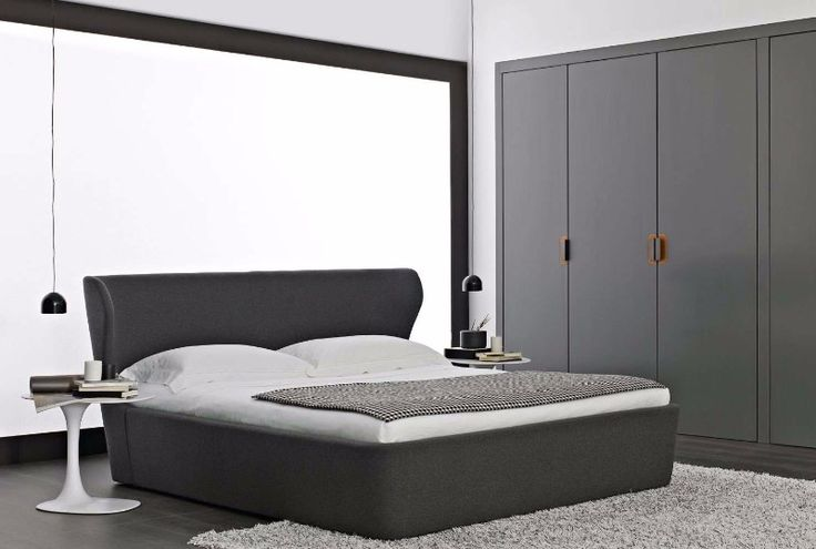 A sleek gray contemporary bedroom featuring the Papilo bed design by B&B Italia.