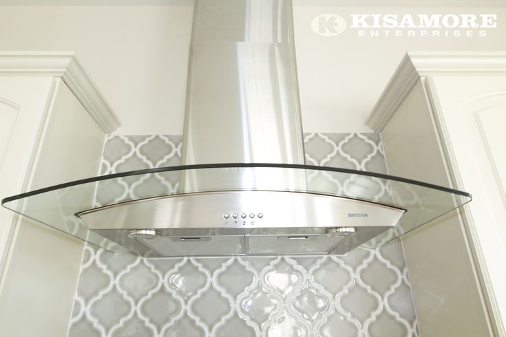 white kitchen ~ gray arabesque backsplash tile ~ white cabinets ~ stainless steel range hood ~ kisamoreenterprises.com  |  LIKE us on Facebook  |  Twitter @KisamoreEnt