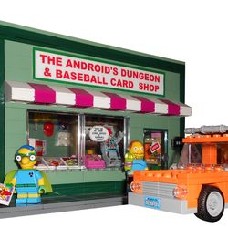 The Android's Dungeon & Baseball Card Shop with the Orange Station Wagon of Marge Simpson The Android's Dungeon and Baseball Card Shop is a local comic book store in Springfield from the tv show The Simpsons. It is owned and run by the Comic Book Guy, Jeffrey Albertson. He sells comics, baseball cards, toys, figurines, vintage video games, etc... The store appears in a lot of episodes of The Simpsons and it is very often frequented by the children of Springfield like Bart and Milhouse. The…