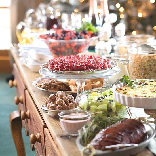 For large party food spreads, set dishes at different levels so the table feels less crowded and guests can easily see every dish. For more buffet serving tips, look here: http://www.bhg.com/christmas/parties/holiday-buffet-serving-tips/?socsrc=bhgpin122714layeredbuffetspread&page=1