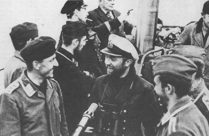 The commander of the submarine U-47 Lieutenant Commander Günther Prien goodbye at the port with the crew of a flying boat shot down over the Atlantic.